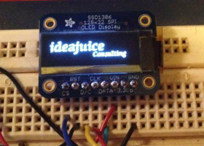 Photo of an OLED display with Ideajuice logo
